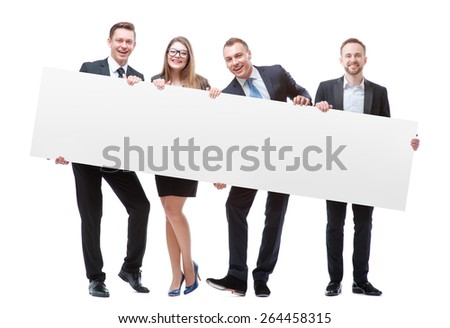 Your advertisement in good hands. Group of handsome young business people holding big blank with copy space. Isolated on white. - stock photo