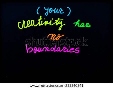Your creativity has no boundaries message, handwriting with chalk on blackboard, free thinking concept - stock photo