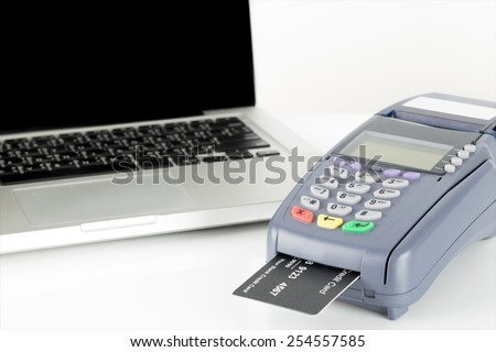 Your Credit Card Swiping On Credit Card Machine And A Laptop with Copyspace For Your Text In Background - stock photo