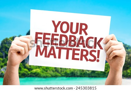 Your Feedback Matters card with a beach on background - stock photo