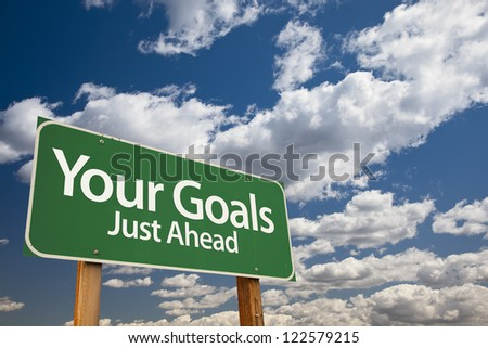 Your Goals Green Road Sign Over Dramatic Clouds and Sky. - stock photo