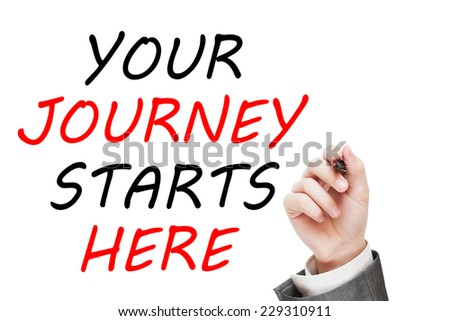 Your Journey Starts Here. Man writing message text isolated on white background - stock photo