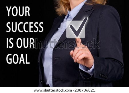 Your Success is our Goal - Businesswoman with touchscreen - stock photo