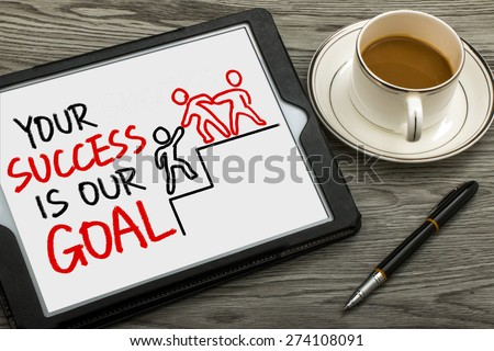 your success is our goal hand drawing on tablet pc - stock photo