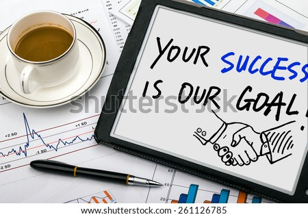 your success is our goal handwritten on tablet pc - stock photo