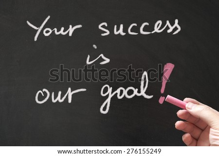 Your success is our goal words written on blackboard using chalk - stock photo