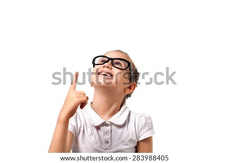 Your text here. Pretty little girl with glasses ointing empty space. Isolated on white. - stock photo