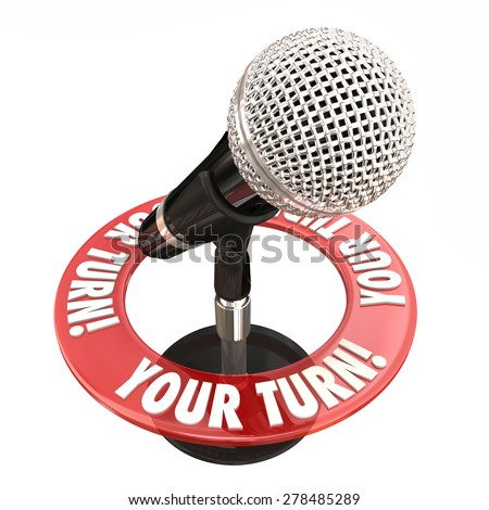 Your Turn words around a microphone to illustrate sharing an opinion and speaking one's mind in a public forum or meeting - stock photo