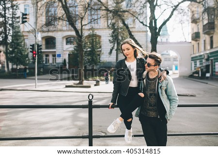 Youth and fashionable couple on the streets.