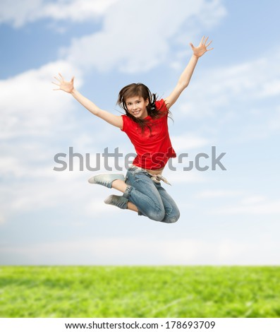 youth and fitness concept - happy girl jumping in the air