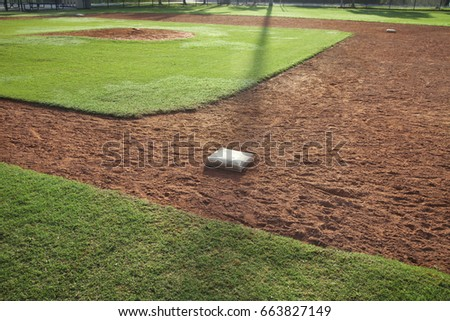 Youth baseball field from first base side in morning light