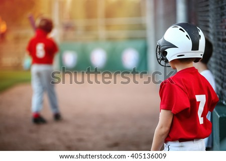 Youth Baseball player waiting on deck in batting line up, focus on boys shoulder - stock photo