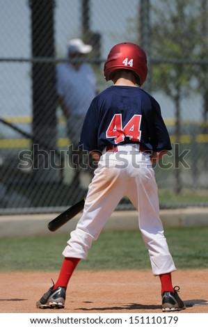 Youth little league lefty at bat - stock photo
