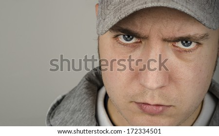 Youth, portrait of a young man wearing a grey baseball cap and hoody - stock photo