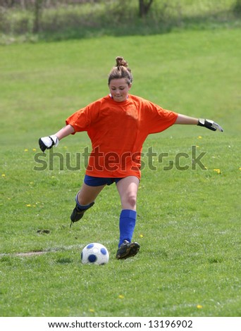 Youth Soccer Goalie Action - stock photo