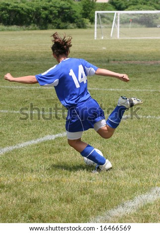 Youth Soccer Player Read to Kick Ball - stock photo
