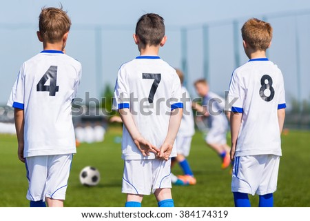 Youth Soccer Team; Reserve Players on a Bench; Boys Ready To Play European Football Match. - stock photo