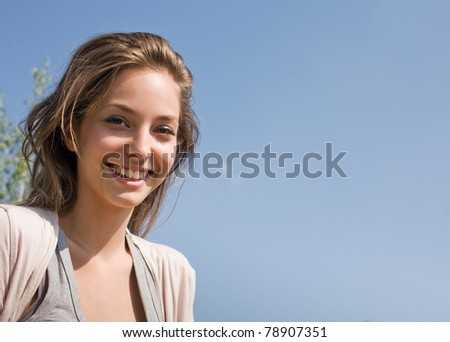 Youth, summer and beauty, outdoors sunlit portrait of a beautiful young brunette girl.