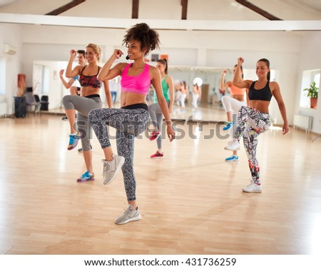 Youth takes care of their appearance using body exercises in fitness center - stock photo