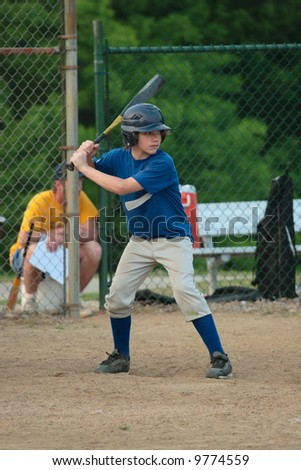 Youth Teen Boy up for Bat at Baseball Game (Batter) - stock photo