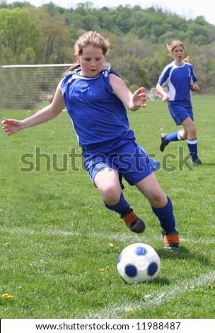 Youth Teen Girls on Field during Soccer Game Play - stock photo