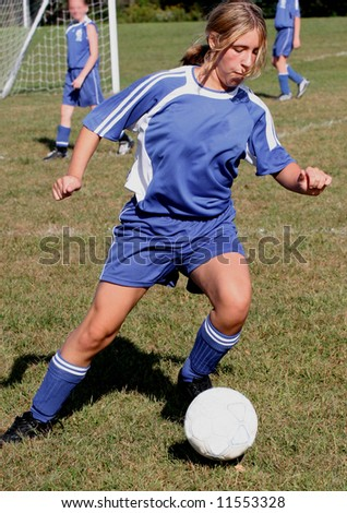 Youth Teen in Action on Soccer Field - stock photo