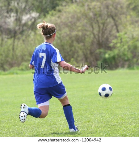 Youth Teen Soccer Play on Field During Game. - stock photo