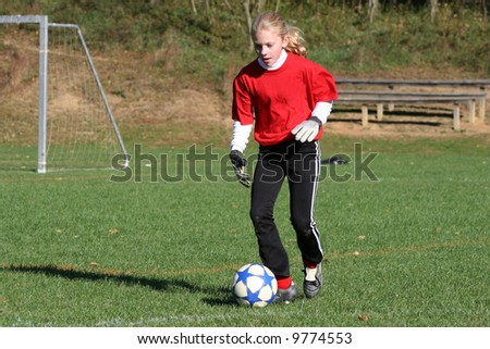 Youth Teen Soccer Player Kicking Ball on Field During Game (2) - stock photo