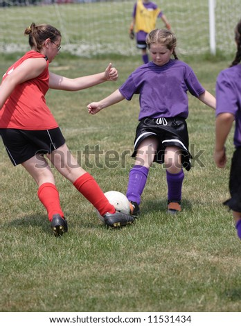 Youth Teen Soccer Players in Action 4 - stock photo