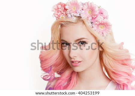 Youth women with colored hair smiling. Flowers in her hair. Studio, isolated, white background. Concept spring, summer. Look at the camera - stock photo
