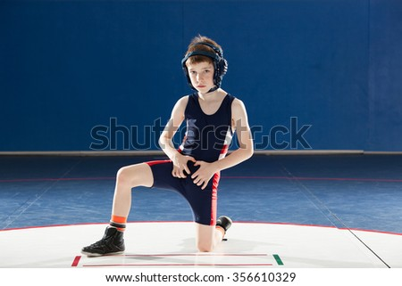 Youth wrestler doing a stand up - stock photo
