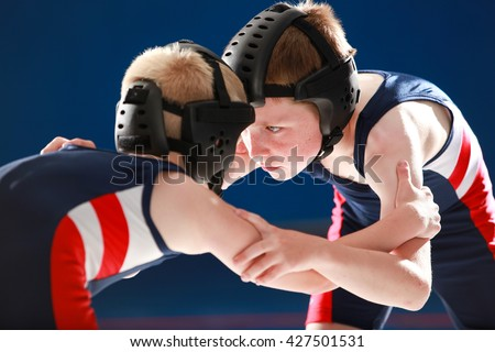 Youth wrestlers practice against each other.  - stock photo