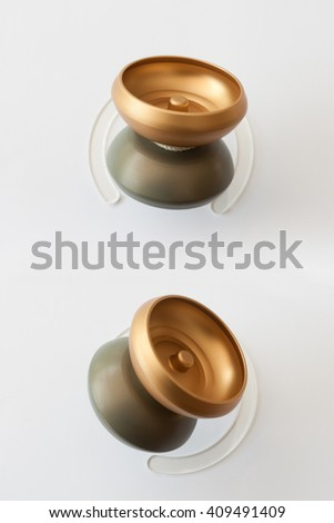 yoyo competition from anodized aluminum with stainless steel ball bearing and ecru ivory on pedestal in double installation - stock photo