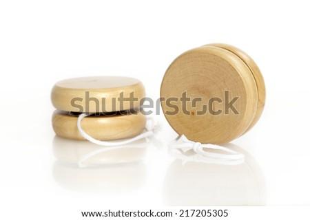 Yoyos on the white background with reflection - stock photo