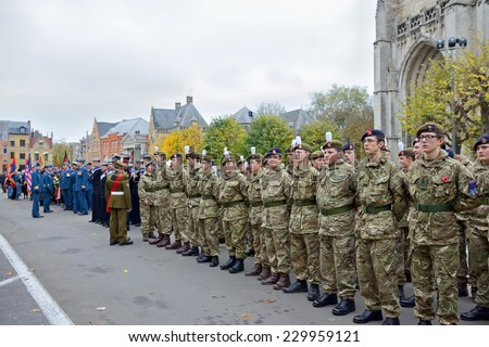 YPRES, BELGIUM-NOVEMBER 11, 2014: Young participants of Poppy Parade commemorating 100 years of World War I are ready to depart from Grand Place to Porte de Menin or Gates of Menin - stock photo