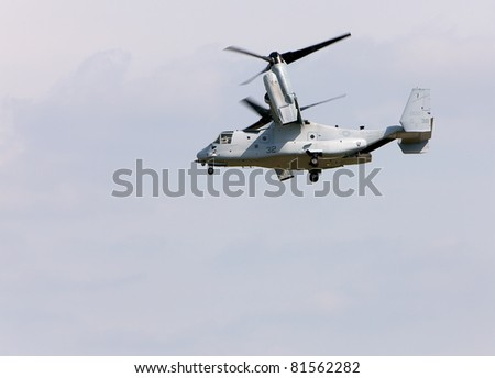 YPSILANTI - JULY 24th : The V22 Osprey performs at the Thunder Over Michigan air show on July 24th, 2011 in Ypsilanti, Michigan.