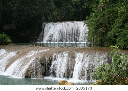 YS River Waterfall in the jungle of Jamaica. - stock photo