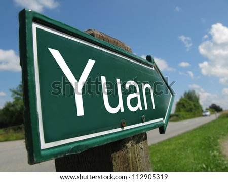 YUAN arrow signpost along a rural road