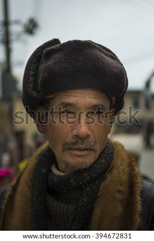 YUANYANG - March 01 2016 :: old man on the street in yunnan, China