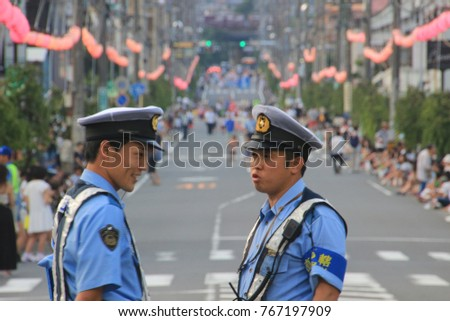Yugawara, Kanagawa / Japan - Aug.3.2017: People and policeman are waiting for festival parade in a main street of the town.
