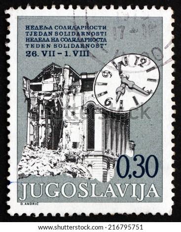 YUGOSLAVIA - CIRCA 1975: a stamp printed in the Yugoslavia shows Ruin and Clock, 1963 Skopje Earthquake, circa 1975 - stock photo