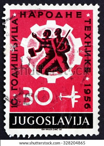 YUGOSLAVIA - CIRCA 1956: a stamp printed in the Yugoslavia shows Workers and Cogwheel, 10th Anniversary of Technical Education, circa 1956