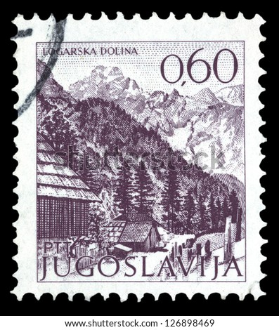 "YUGOSLAVIA - CIRCA 1972: A stamp printed in Yugoslavia shows city view of Logarska Dolina, with the same inscription, from series ""Yugoslavia city views "", circa 1972"