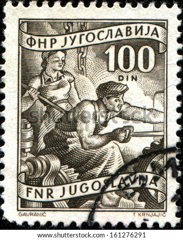 "YUGOSLAVIA - CIRCA 1950: A stamp printed in Yugoslavia shows metallurgists, series ""Domestic economy"", circa 1950  - stock photo"