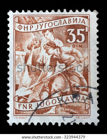 YUGOSLAVIA - CIRCA 1952: A stamp printed in Yugoslavia shows working at a construction site, domestic economy Series, stamp for surcharges, circa 1952 - stock photo