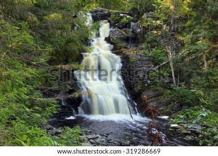 Yukankoski waterfall (white bridges) on the river Kulismayoki, Russia, Karelia - stock photo