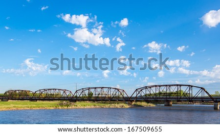 YUKON, OK/USA - MAY 5: Lake Overholsler Bridge, part of Route 66, crosses the N. Canadian River, on May 5, 2013, in Yukon, Oklahoma. National Register of Historic Places - stock photo