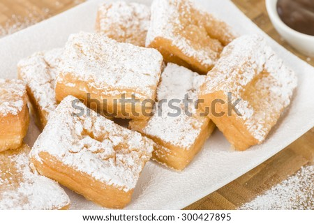 Yum Yum - Sweet toffee flavoured fried pastry dusted with icing sugar ...