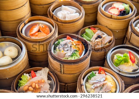 yumcha, dim sum in bamboo steamer, chinese cuisine - stock photo