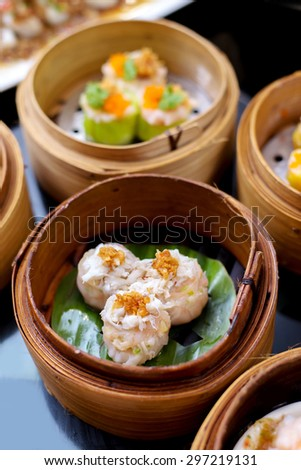 yumcha, steamed dumpling , crab shumai dim sum in bamboo steamer of chinese restaurant - stock photo